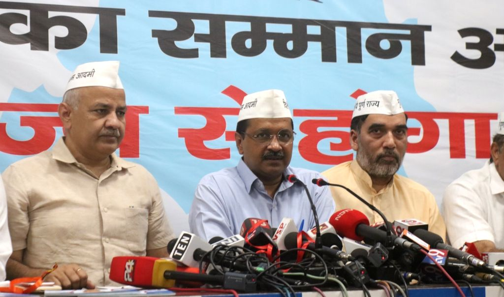 New Delhi: Delhi Chief Minister Arvind Kejriwal accompanied by Deputy Chief Minister Manish Sisodia and Cabinet Minister Gopal Rai, addresses a press conference after releasing AAP's election manifesto for the 2019 Lok Sabha elections, in New Delhi o - Arvind Kejriwal and Gopal Rai