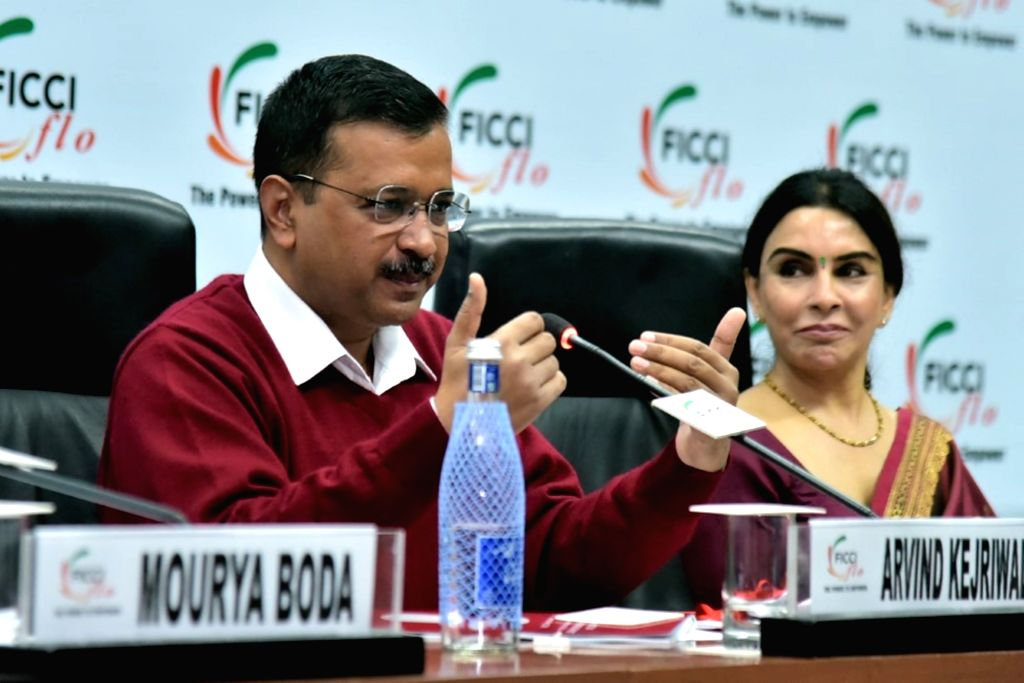 New Delhi: Delhi Chief Minister Arvind Kejriwal accompanied by FICCI Ladies Organisation (FLO) President Harjinder Kaur, addresses during an interactive session, in New Delhi on Dec 13, 2019. (Photo: IANS) - Arvind Kejriwal and Harjinder Kaur