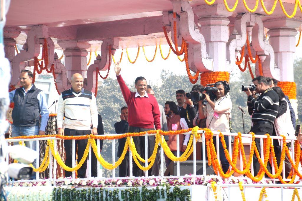 New Delhi: Delhi Chief Minister Arvind Kejriwal and Cabinet Ministers Manish Sisodia and Satyendra Kumar Jain wave at the audience after taking oath at Ramlila Maidan on Feb 16, 2020. (Photo: IANS) - Arvind Kejriwal, Manish Sisodia and Satyendra Kumar Jain