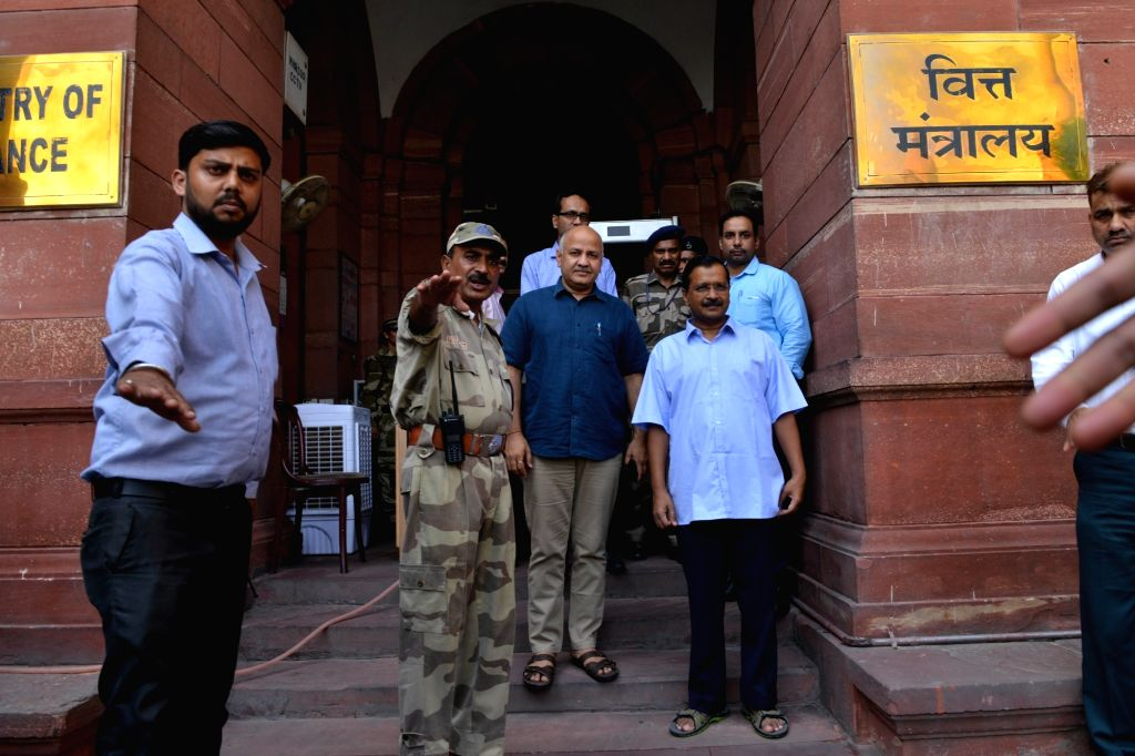 New Delhi: Delhi Chief Minister Arvind Kejriwal and Deputy Chief Minister Manish Sisodia come out after meeting Union Finance and Corporate Affairs Minister Nirmala Sitharaman, in New Delhi on June 27, 2019. (Photo: IANS) - Arvind Kejriwal