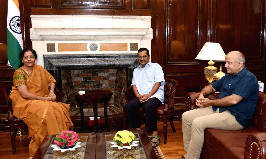 New Delhi: Delhi Chief Minister Arvind Kejriwal and Deputy Chief Minister Manish Sisodia meet Union Finance and Corporate Affairs Minister Nirmala Sitharaman, in New Delhi on June 27, 2019. (Photo: IANS/PIB) - Arvind Kejriwal