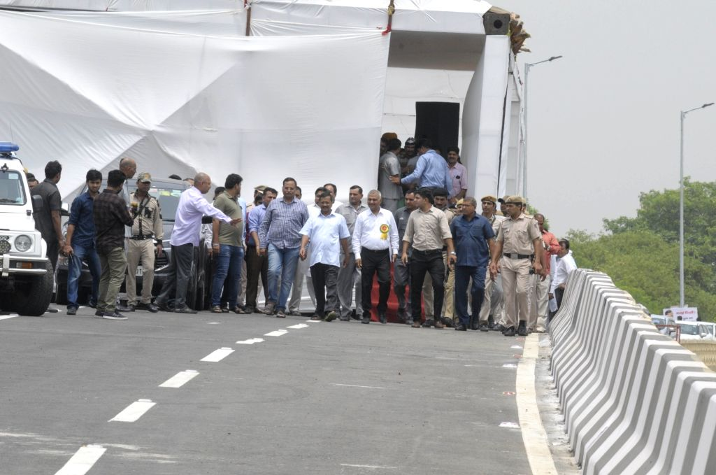 New Delhi: Delhi Chief Minister Arvind Kejriwal and Public Works Department Minister Satyendra Kumar Jain arrive to inaugurate the newly constructed Rao Tula Ram (RTR) Flyover at Outer Ring Road near Munirka in New Delhi, on July 16, 2019. (Photo: IA - Arvind Kejriwal and Satyendra Kumar Jain
