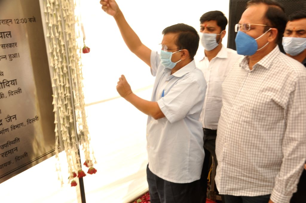New Delhi: Delhi Chief Minister Arvind Kejriwal and Urban Development and Transport Minister Satyendra Jain unveil the plaque to inaugurate the newly-constructed Seelampur-Shastri Park flyover, in New Delhi on Oct 24, 2020. (Photo: IANS) - Arvind Kejriwal and Satyendra Jain
