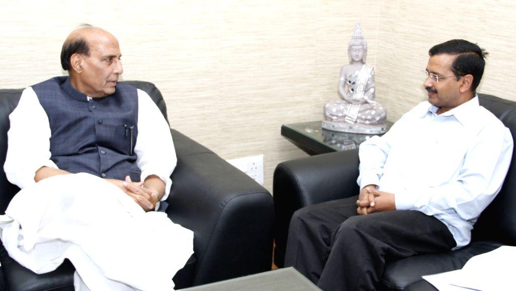 :New Delhi: Delhi Chief Minister Arvind Kejriwal calls on the Union Home Minister Rajnath Singh, in New Delhi on Nov. 5, 2015. (Photo: IANS/PIB). - Arvind Kejriwal and Rajnath Singh