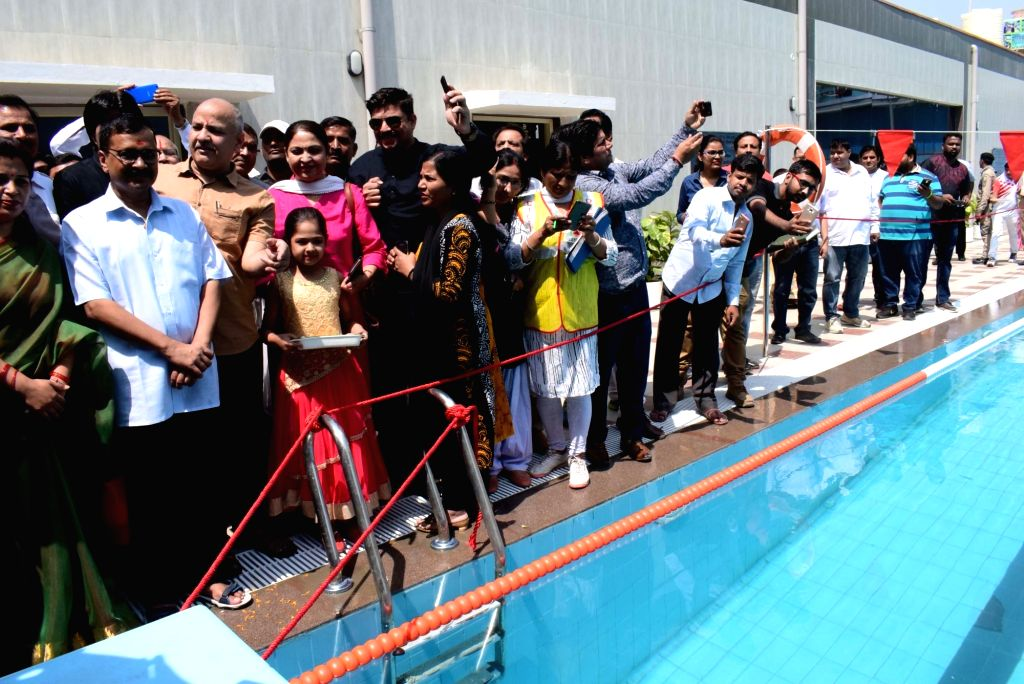New Delhi: Delhi Chief Minister Arvind Kejriwal, Deputy Chief Minister and Education Minister Manish Sisodia and other dignitaries during a programme organised to inaugurate swimming pools in two Delhi government schools, in New Delhi on April 7, 201 - Arvind Kejriwal