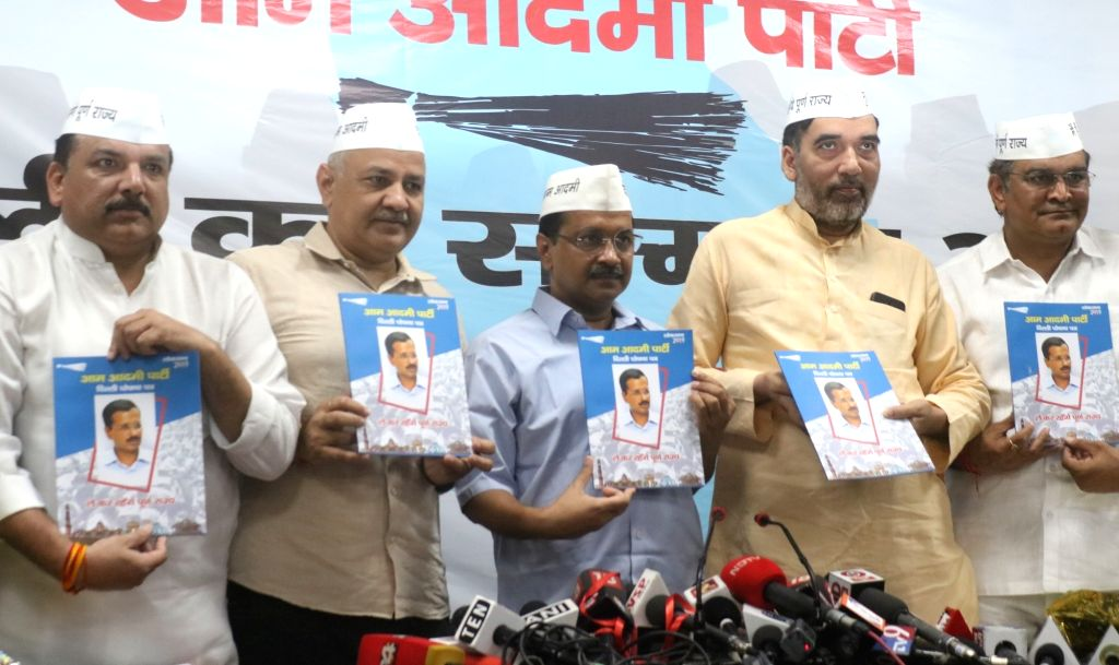 New Delhi: Delhi Chief Minister Arvind Kejriwal, Deputy Chief Minister Manish Sisodia, Cabinet Minister Gopal Rai, party leader Sanjay Singh and AAP's Lok Sabha candidate from North West Delhi, Gugan Singh Ranga release the party's election manifesto - Arvind Kejriwal, Gopal Rai, Sanjay Singh and Gugan Singh Ranga