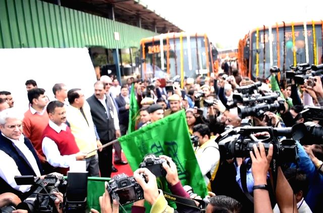 New Delhi: Delhi Chief Minister Arvind Kejriwal flags off 100 standard floor buses equipped with hydraulic lifts, CCTV cameras and panic button under the cluster scheme, in New Delhi on Nov 28, 2019. (Photo: IANS) - Arvind Kejriwal