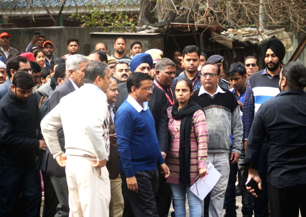 New Delhi: Delhi Chief Minister Arvind Kejriwal visit the site where a child and 16 others, including a woman was killed in a major fire  that engulfed several storeys of a central Delhi hotel on Feb. 12, 2019.(Photo: IANS) - Arvind Kejriwal