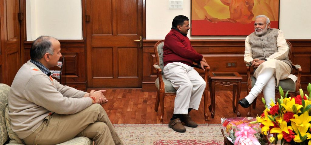 Delhi Chief Minister-designate Arvind Kejriwal, and Aam Aadmi Party (AAP) leader Manish Sisodia call on the Prime Minister Narendra Modi, in New Delhi on Feb 12, 2015. - Narendra Modi