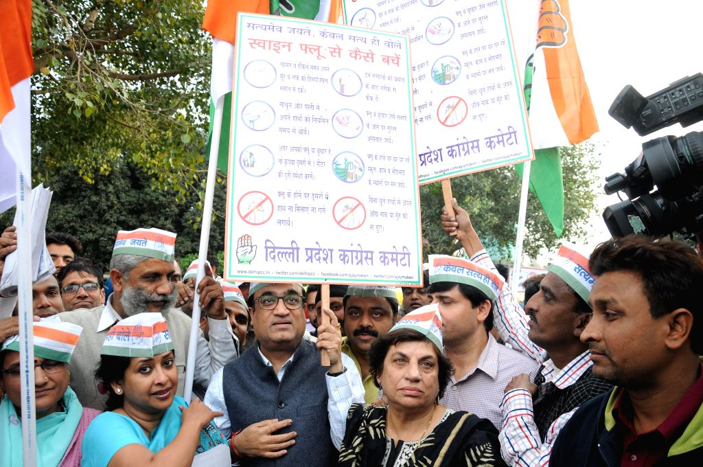 Delhi Congress chief Ajay Maken with Kiran Walia, Sharmistha Mukherjee and other party leaders during a swine flu awareness campaign in New Delhi on March 11, 2015. - Sharmistha Mukherjee