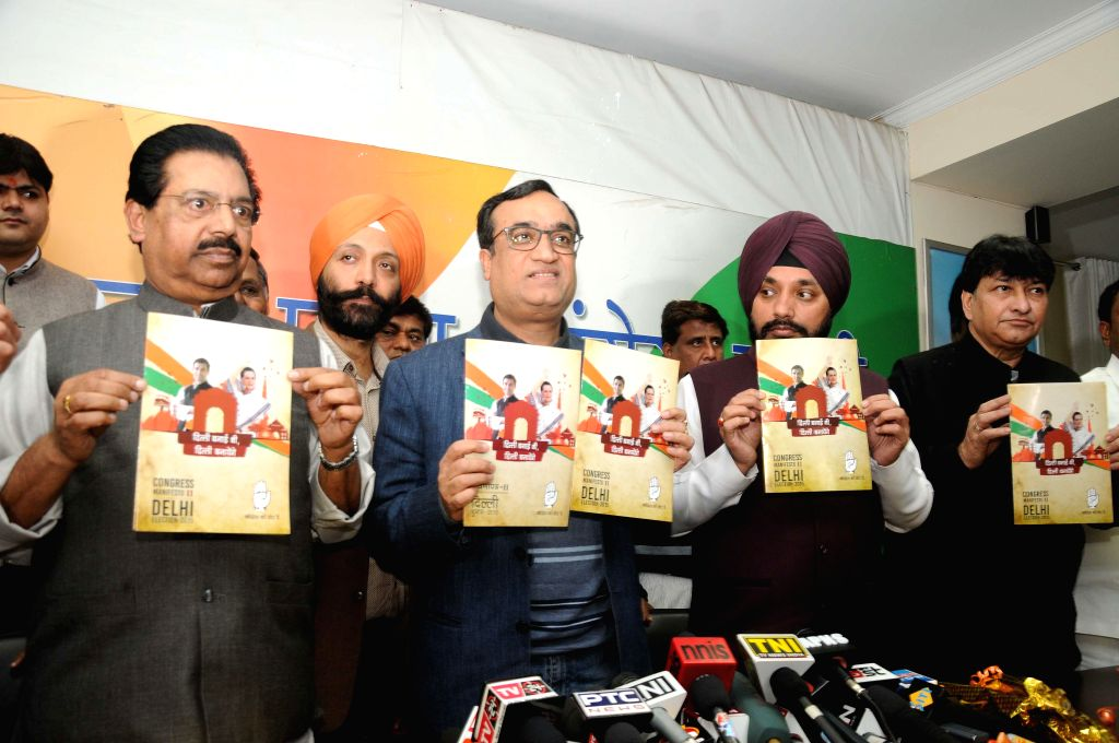 Delhi Congress chief Arvinder Singh Lovely with senior leaders Ajay Maken and P C Chacko during the release of Congress party election manifesto at party office in New Delhi on Feb. 3, ... - Arvinder Singh Lovely