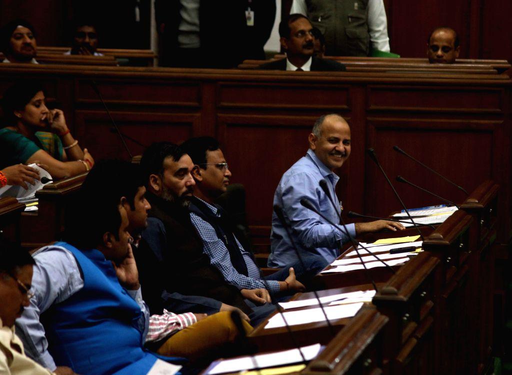Delhi Deputy Chief Minister Manish Sisodia with cabinet ministers Gopal Rai, Satyendra Jain and others during a Delhi Legislative Assembly session in New Delhi, on Feb 23, 2015. - Manish Sisodia, Gopal Rai and Satyendra Jain