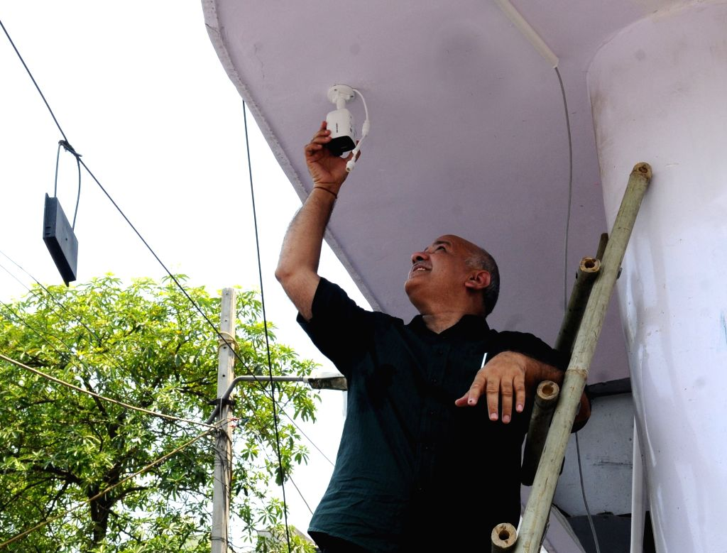 New Delhi: Delhi Deputy Chief Minister Manish Sisodia seen installing CCTV cameras, in New Delhi, on June 23, 2019. (Photo: IANS) - Manish Sisodia