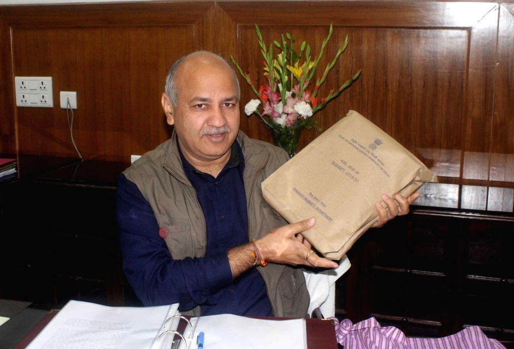 New Delhi: Delhi Finance Minister Manish Sisodia before presenting the state budget for 2019-20 at state assembly in New Delhi on Feb 26, 2019. (Photo: IANS) - Manish Sisodia