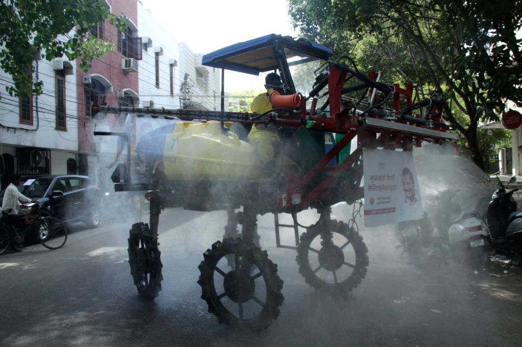New Delhi: Delhi Government sanitation vehicle spraying chemical fumigation during the nationwide during the nationwide lockdown announced by Prime Minister Narendra Modi as a precautionary measure to contain the spread of COVID-19, in New Delhi on A - Narendra Modi