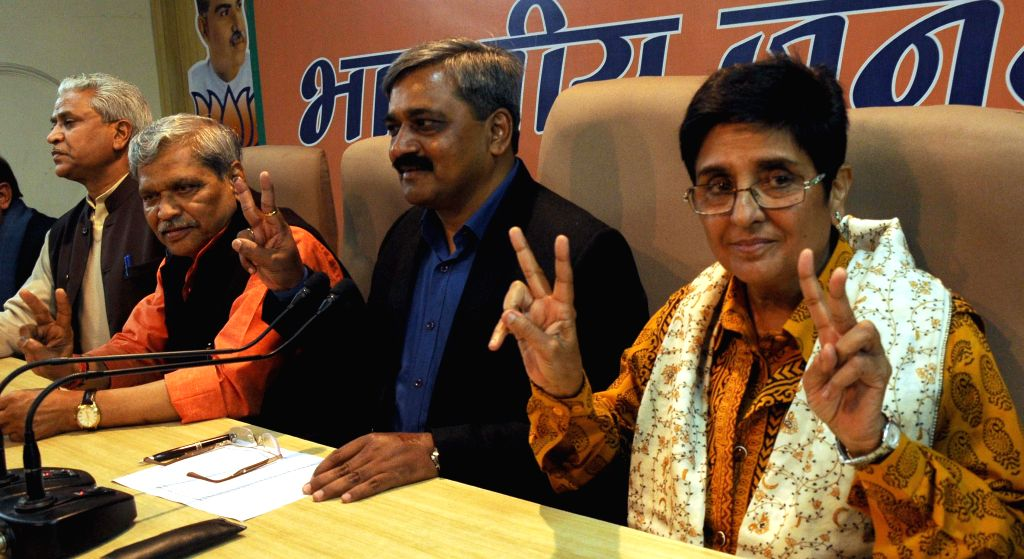 Delhi in-charge of BJP Prabhat Jha, Delhi BJP chief Satish Upadhyay, BJP's chief ministerial candidate for Delhi Kiran Bedi during a review meeting in New Delhi, on Feb 8, 2015. - Satish Upadhyay and Kiran Bedi