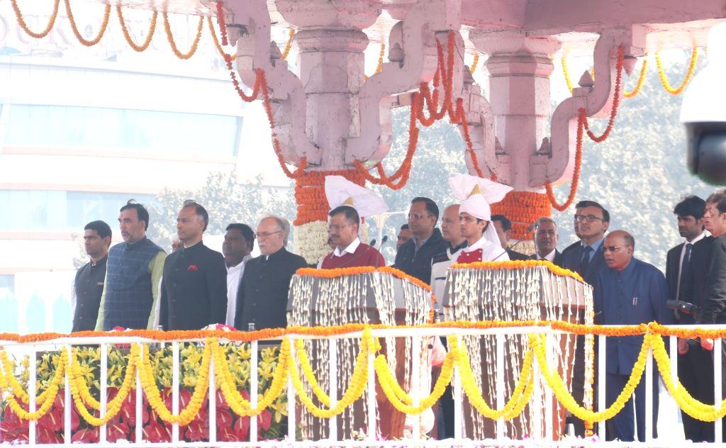 New Delhi: Delhi Lieutenant Governor Anil Baijal and AAP chief Arvind Kejriwal stand for National Anthem ahead of the latter's swearing-in as the Chief Minister of Delhi at the Ramlila Maidan, on Feb 16, 2020. Also seen AAP leaders Manish Sisodia, Sa - Arvind Kejriwal, Satyendra Kumar Jain and Gopal Rai
