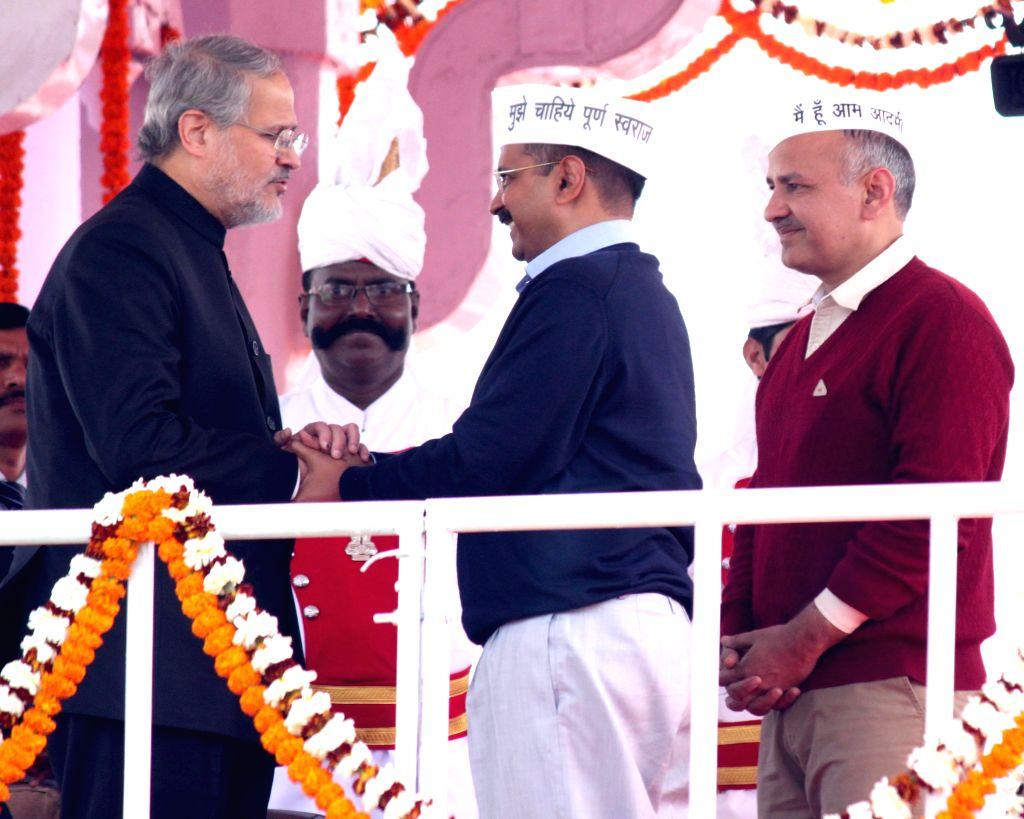Delhi Lieutenant Governor Najeeb Jung with Aam Aadmi Party (AAP) leader Manish Sisodia and Delhi Chief Minister Arvind Kejriwal at Ramlila Maidan in New Delhi, on Feb 14, 2015. - Arvind Kejriwal