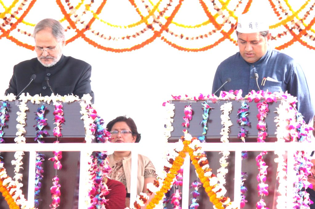 Delhi Lieutenant Governor Najeeb Jung administers oath of office to the Aam Aadmi Party (AAP) leader Sandeep Kumar as a minister in the Kejriwal government at Ramlila Maidan in New Delhi, . - Sandeep Kumar