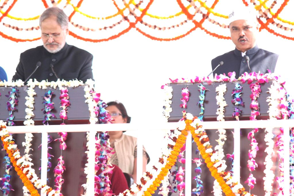 Delhi Lieutenant Governor Najeeb Jung administers oath of office to the Aam Aadmi Party (AAP) leader Jitendra Singh Tomar as a minister in the Kejriwal government at Ramlila Maidan in New . - Jitendra Singh Tomar