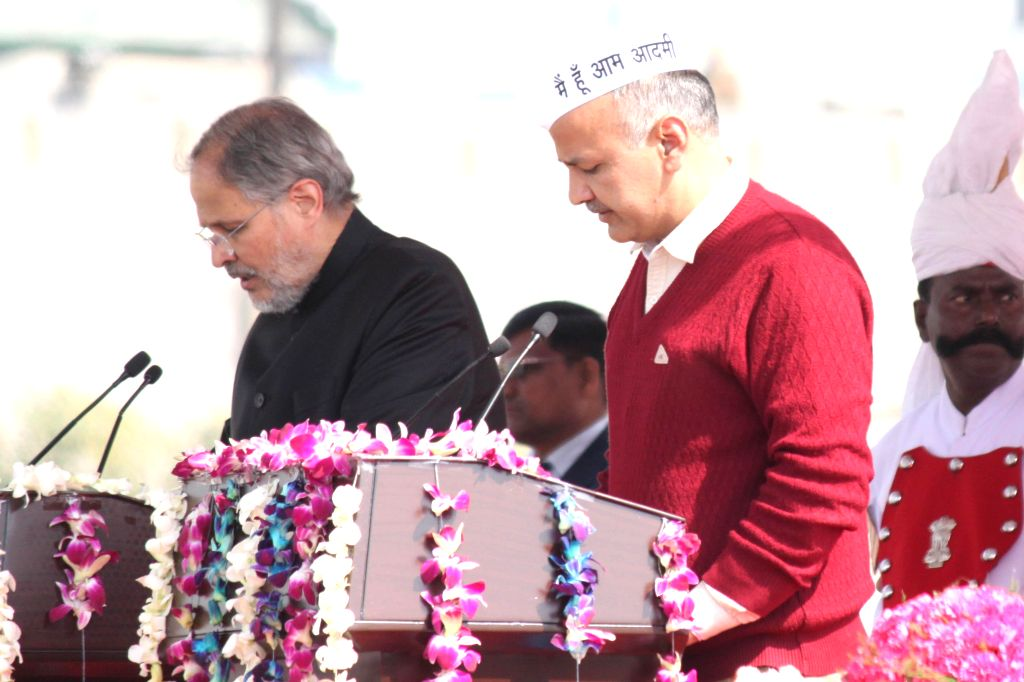Delhi Lieutenant Governor Najeeb Jung administers oath of office to the Aam Aadmi Party (AAP) leader Manish Sisodia as a minister in the Kejriwal government at Ramlila Maidan in New Delhi,