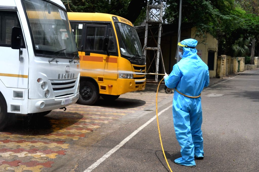 New Delhi: Delhi Municipal Corporation employee spraying disinfectant to sanitize the Hindu Rao hospital after a Nurse tested positive for Covid 19 during the Nationwide lockdown in New Delhi on April 26, 2020. (Photo: IANS) - Rao