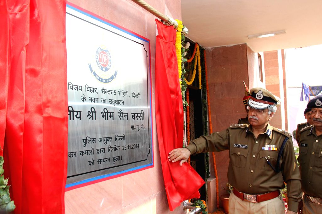Delhi Police Commissioner BS Bassi inaugurates a police building in New Delhi on Nov 25, 2014.