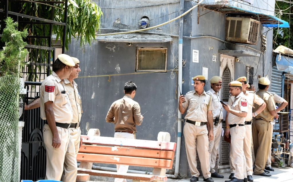 New Delhi: Delhi police deployed outside the house, where a couple and a maid were found dead with their throats slit inside a house in New Delhi's Vasant Vihar, on June 23, 2019. (Photo: IANS)