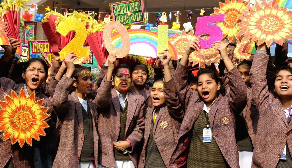 Delhi students welcome 2015 in New Delhi, on Dec 31, 2014.