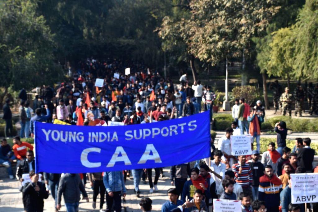 "New Delhi: Delhi University students, led by the Akhil Bharatiya Vidyarthi Parishad (ABVP) and Delhi University Students' Union (DUSU), march to protest against ""left sponsored"" violence in Jawaharlal Nehru University (JNU) and to express support for"