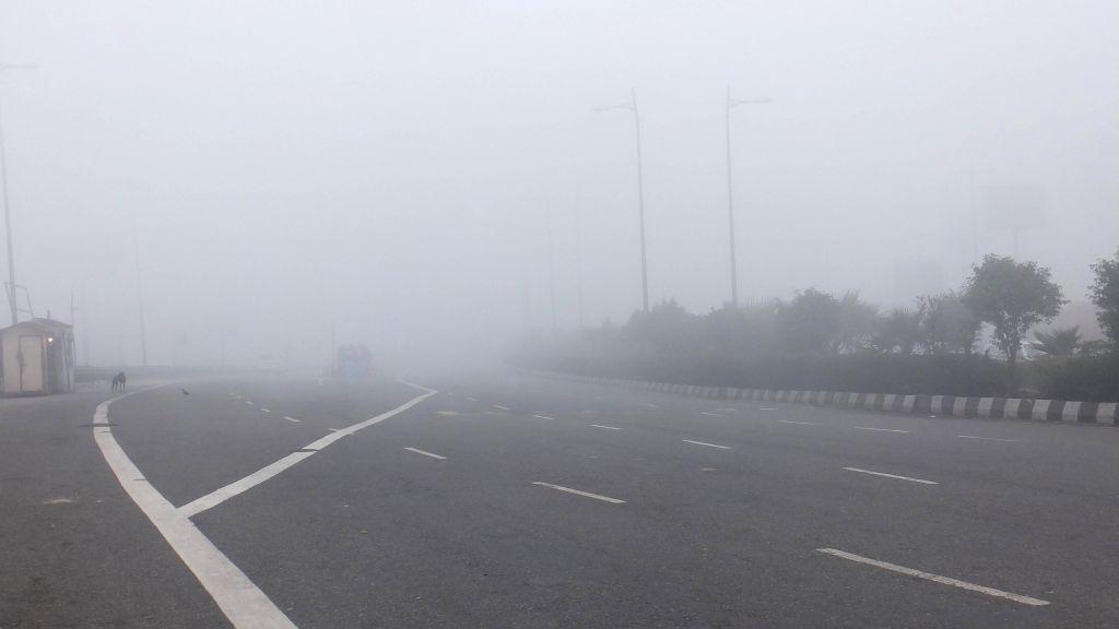 Delhi wakes to a foggy morning on Jan 13, 2015.