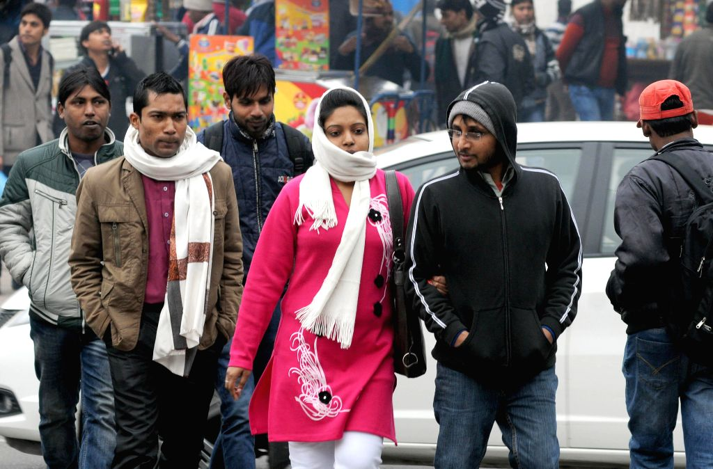 Delhiites wake to a chilly morning on Jan 15, 2015. The minimum temperature was 5.8 degrees Celsius - two notches below the season's average. According the Northern Railway, 57 trains ...