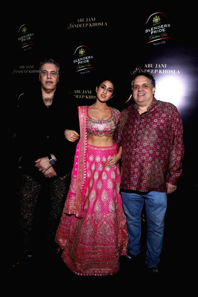 New Delhi: Designer Abu Jani, showstopper Sara Ali Khan and designer Sandeep Khosla at the 15th edition of the Blenders Pride Fashion Tour 2019-20 in New Delhi. (Photo: IANS) - Sara Ali Khan