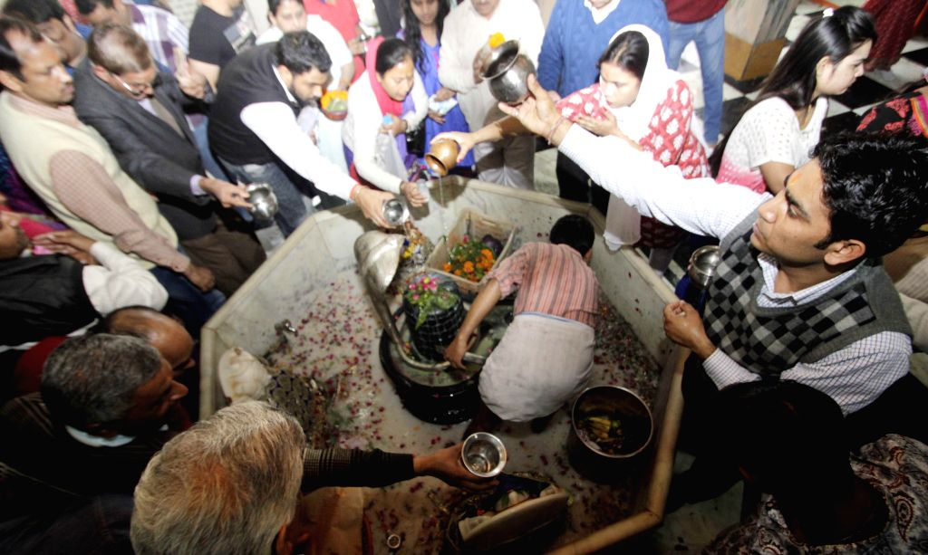 Devotees throng a Shiva temple at Connaught Place of New Delhi on Mahashivratri, on Feb 17, 2015.