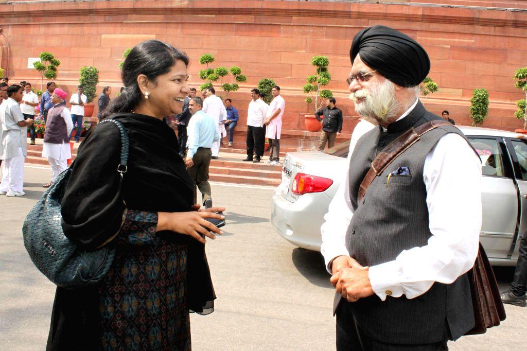 DMK MP Kanimozhi and Rajya Sabha MP KTS Tulsi at the Parliament in New Delhi, on March 13, 2015.