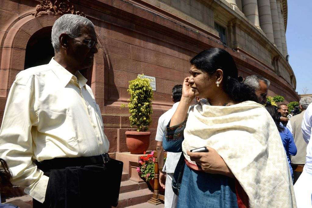 DMK MP Kanimozhi with CPI leader D Raja at the Parliament in New Delhi, on March 20, 2015.
