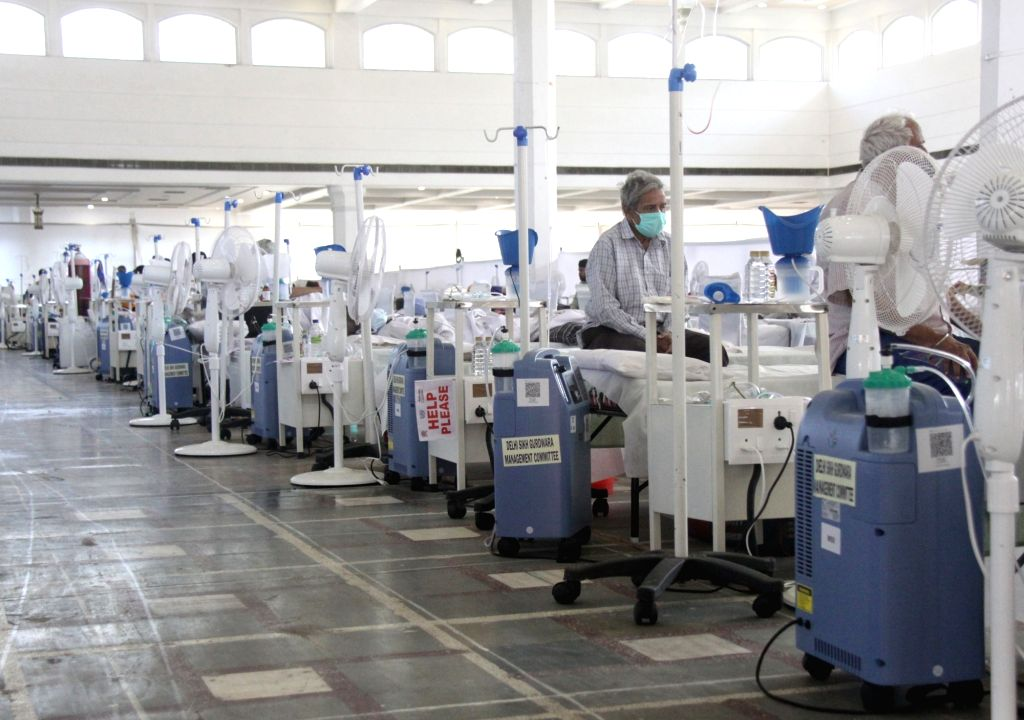 New Delhi : Doctors wearing PPE coveralls attend to Covid-19 Patients housed in Guru Tegh Bahadur Medical Isolation & Treatment Centre, Gurudwara Rakabganj, the centre 400 Oxygen beds facility ...