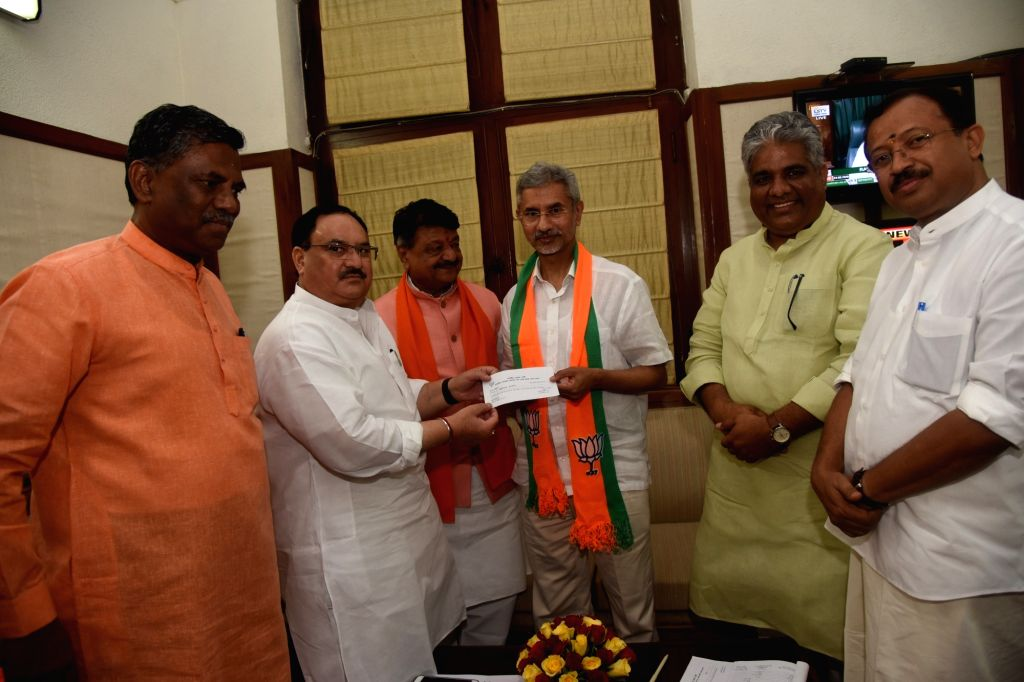 New Delhi: External Affairs Minister S. Jaishankar joins the BJP in the presence of the party's National Working President J.P. Nadda at the party's Parliamentary Office, in New Delhi on June 24, 2019. Also seen MoS External Affairs V. Muraleedharan  - S. Jaishankar and Bhupender Yadav