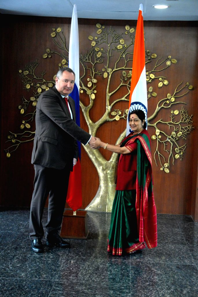 External Affairs Minister Sushma Swaraj with the Deputy Prime Minister of Russia Dmitry Rogozin, at 20th India-Russia Inter-Governmental Commission Meeting in New Delhi, on Nov 5, 2014. - Sushma Swaraj