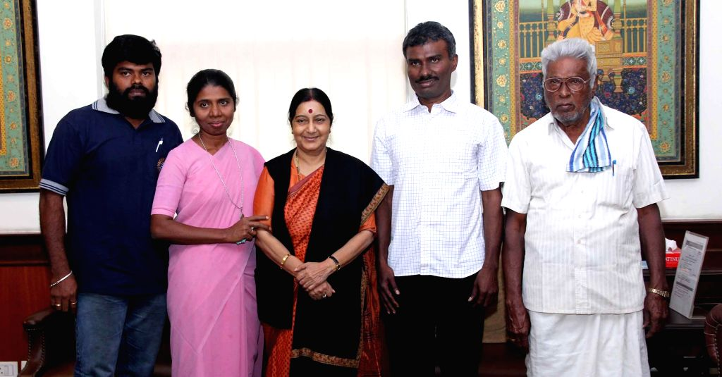 External Affairs Minister Sushma Swaraj with Father Alexis Premkumar Antonysamy, who return to India after spending eight months in captivity in Afghanistan and his family; in New Delhi, ...