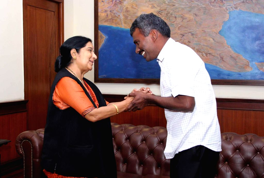 External Affairs Minister Sushma Swaraj welcomes back Father Alexis Premkumar Antonysamy on his return to India after spending eight months in captivity in Afghanistan; in New Delhi, on ...