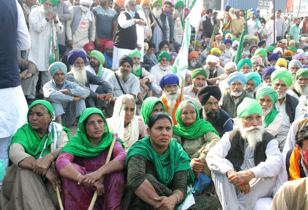 New Delhi: Farmers from Punjab and Haryana continue to protest for the seventh consecutive day, against the Central Government's new Farm Laws, at Delhi-Haryana's Tikri Border on Dec 2, 2020. (Photo: IANS)