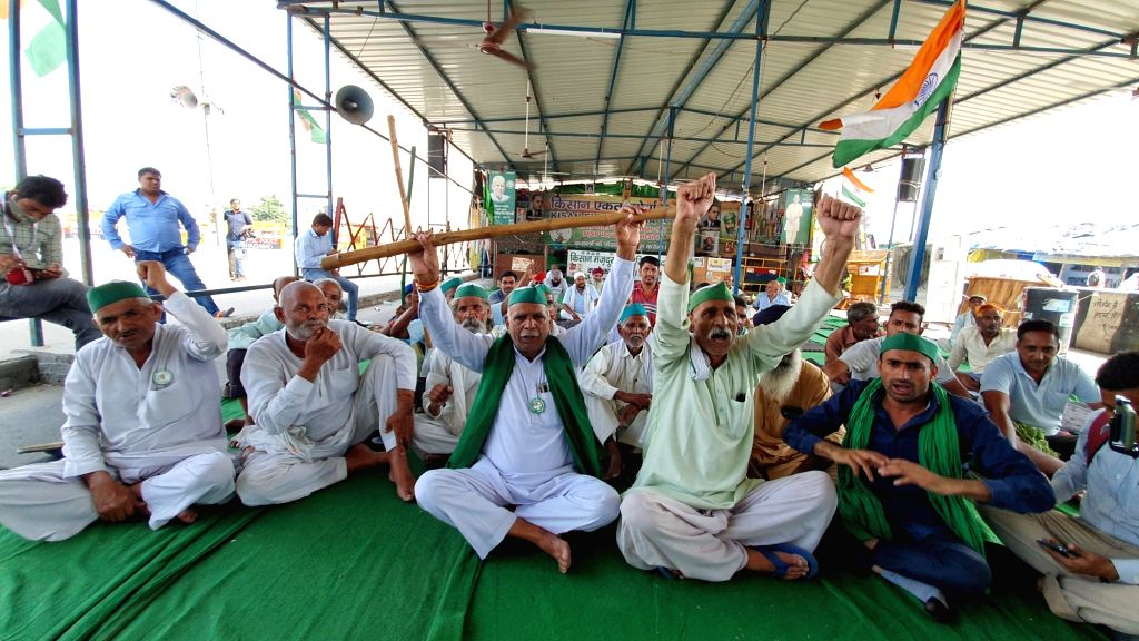 New Delhi : Farmers sit on protest on NH-9 at UP gate over the Lakhimpur Kheri incident in Ghaziabad District on Monday October 04, 2021.