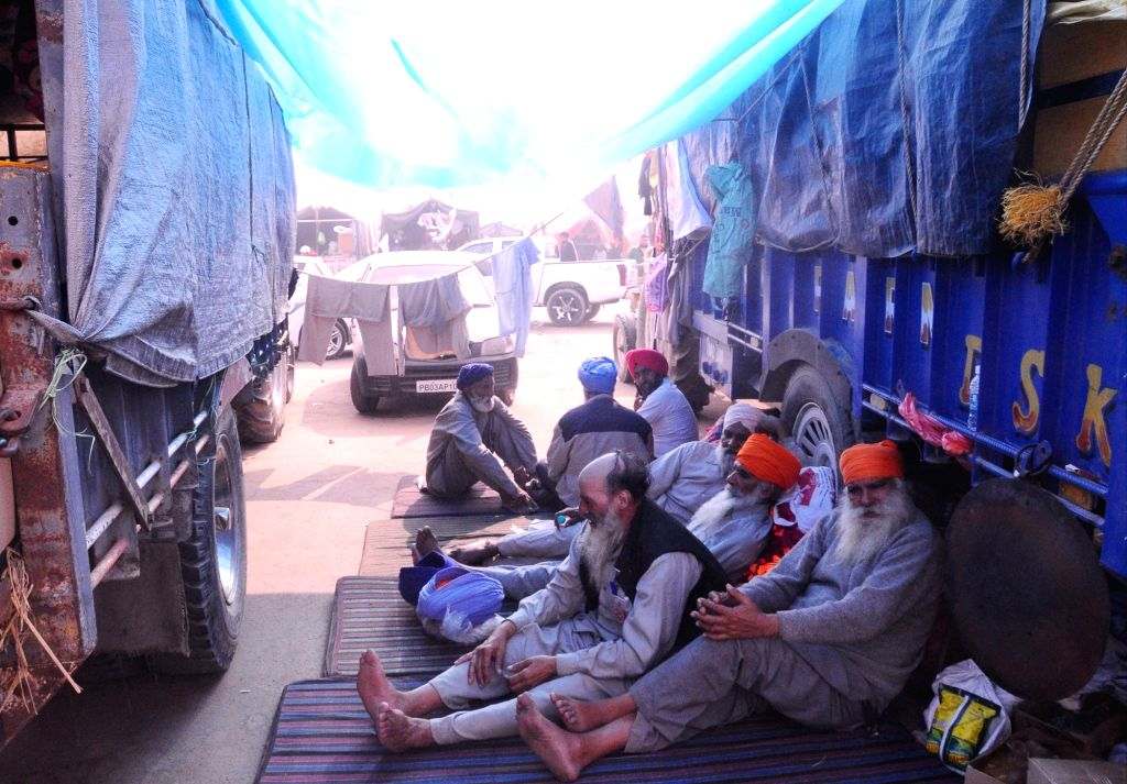 New Delhi: Farmers take a nap besides their trucks at Delhi-Haryana's Singhu Border on the 12th day of their protest against the Central Government's three contentious farm laws, on Dec 7, 2020. (Photo: IANS)