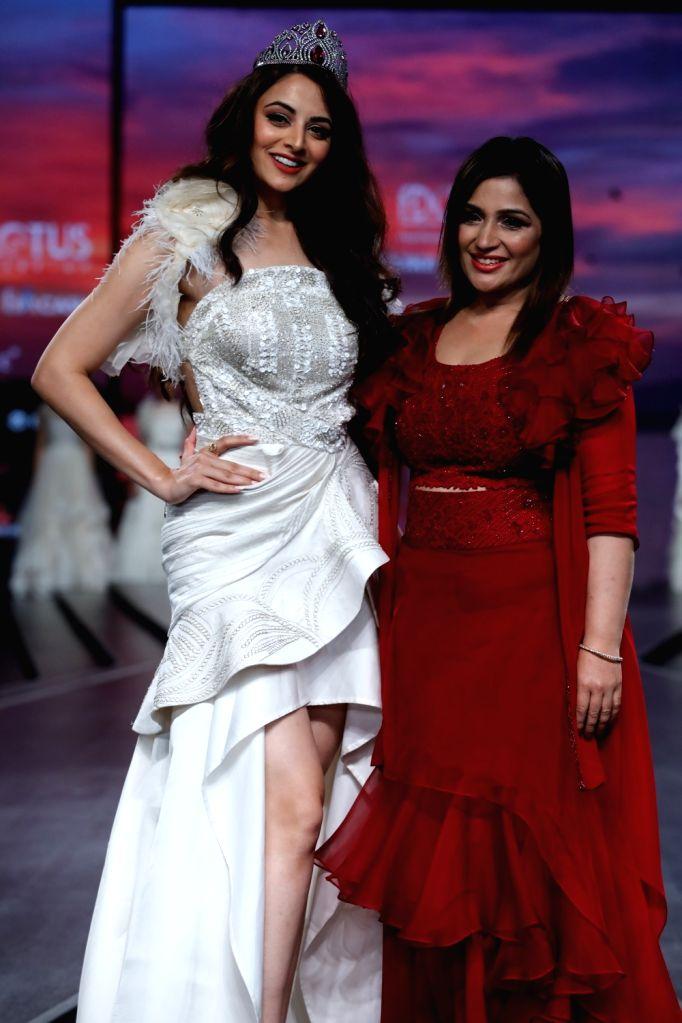 New Delhi: Fashion designer Anju Jain with showstopper Zoya Afroz on the second day of Lotus Make-up India Fashion Week, in New Delhi on Oct 10, 2019. (Photo: IANS) - Anju Jain