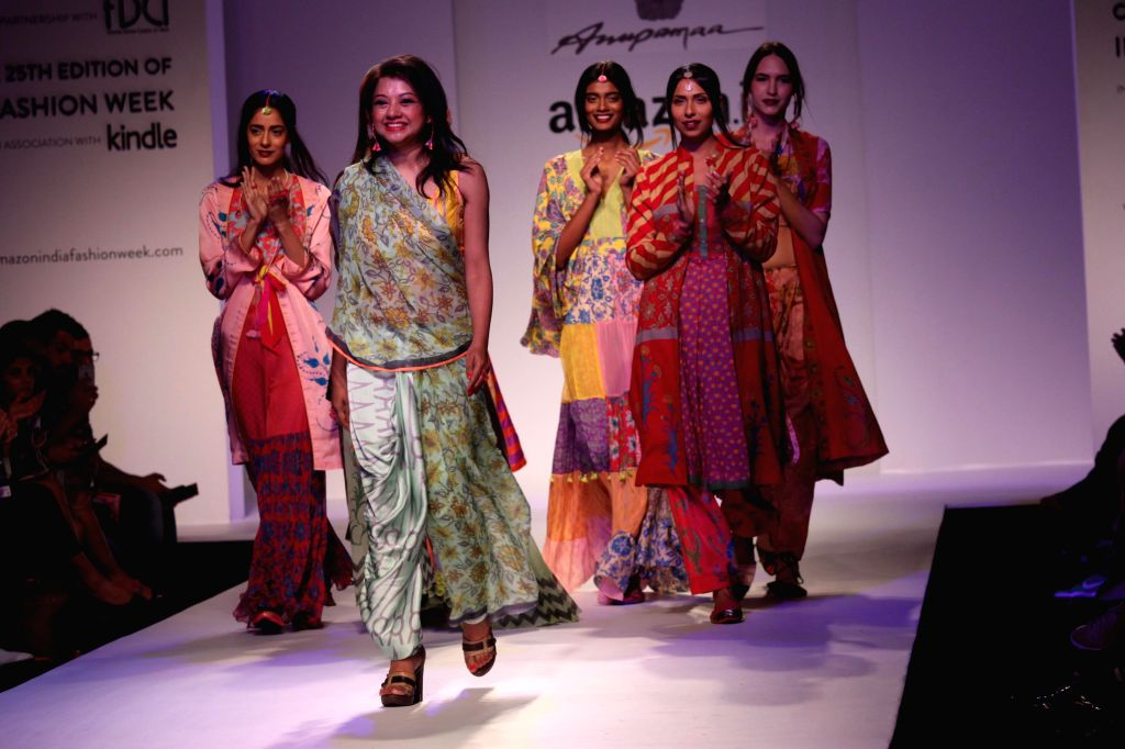 Fashion designer Anupama Dayal with the models showcasing her creations at the Amazon India Fashion Week in New Delhi, on March 27, 2015.