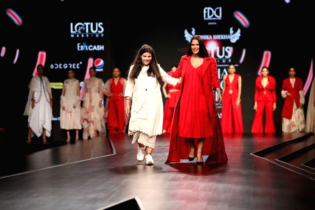 New Delhi: Fashion designer Nidhika Shekhar with actress Neha Dhupia on the third day of Lotus Make-up India Fashion Week, in New Delhi on Oct 11, 2019. (Photo: Amlan Paliwal/IANS) - Neha Dhupia