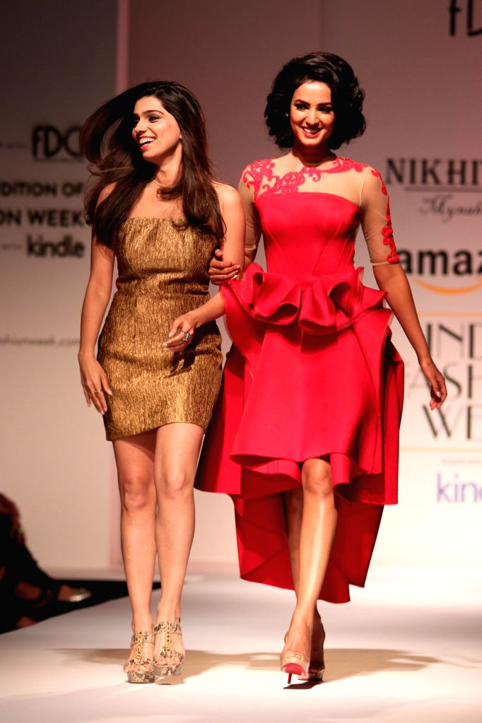 Fashion designer Nikhita Tandon with actress Sonal Chauhan during her show at the Amazon India Fashion Week in New Delhi, on March 28, 2015. - Sonal Chauhan