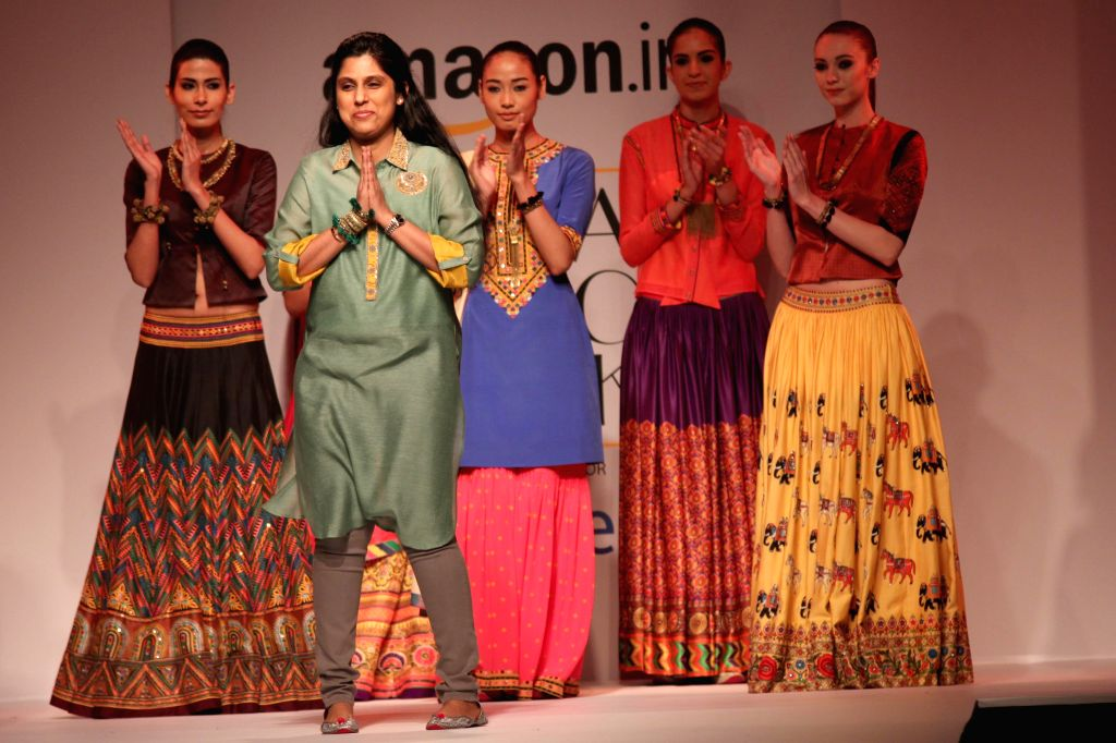 Fashion designer Tanvi Kedia with models showcasing her creations at the Amazon India Fashion Week in New Delhi, on March 27, 2015.
