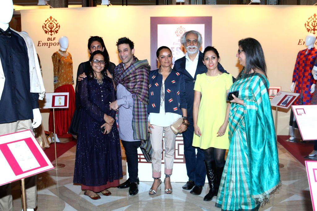 Fashion designers Sunil Sethi, Suneet Verma, Anju Modi, Bandana Tiwari, Ambika Anand and Dinaz Madhukar during the DLF Emporio Design Awards 2014-2015 in New Delhi on Feb 18, 2015. - Suneet Verma and Anju Modi